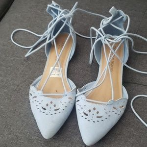 Soft baby blue flats with ankle tie laces